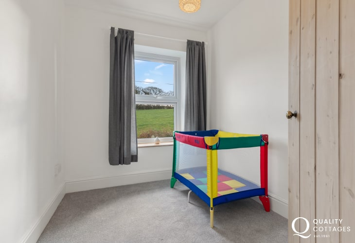 Travel cot available for infants in holiday cottage near Narberth, Pembrokeshire. Sleeps four.