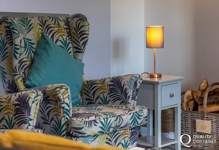 Stylish wing-back armchairs in lounge of luxury holiday cottage near Narberth, Pembrokeshire. Sleeps four.
