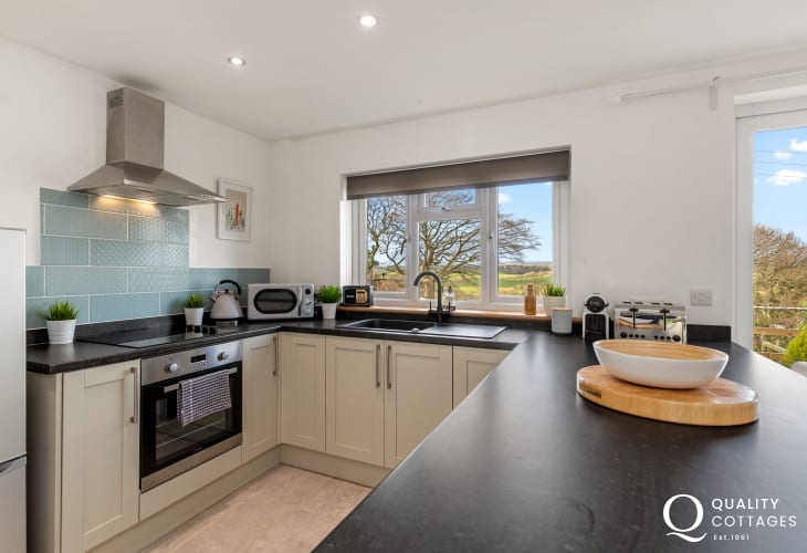 Self catering holiday cottage in Pembrokeshire - modern well appointed kitchen with built in appliances and kitchen island.