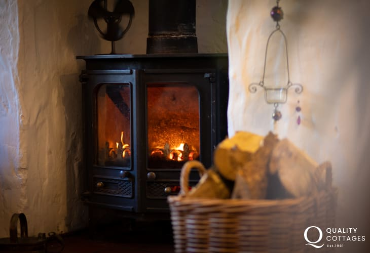 Wood-burning stove in traditional holiday cottage in rural Bosherton, Pembrokeshire.