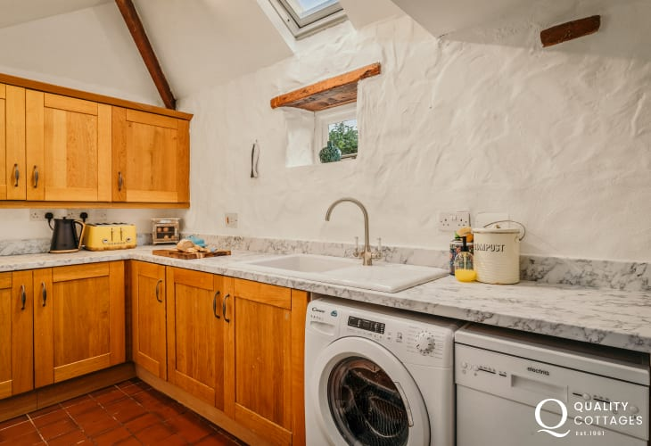 Shaker style kitchen with appliances in self-catering holiday cottage in Bosherton, Pembrokeshire.