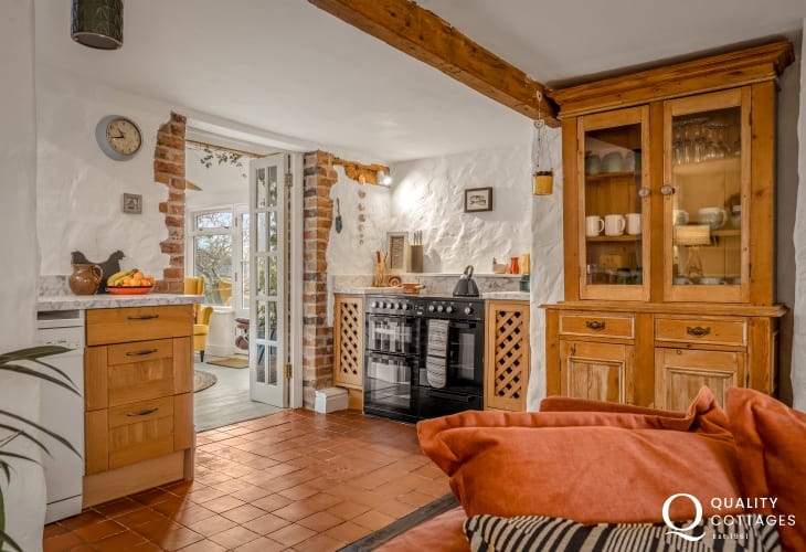 Range cooker in kitchen leading through to dining room - holiday cottage in Bosherton, Pembrokeshire.