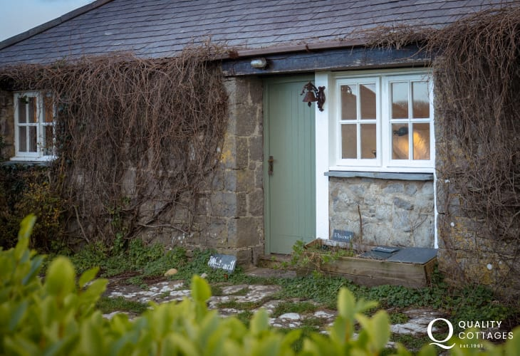 View of Whitewell's front door, traditional stone holiday cottage in Bosherton, Pembrokeshire.