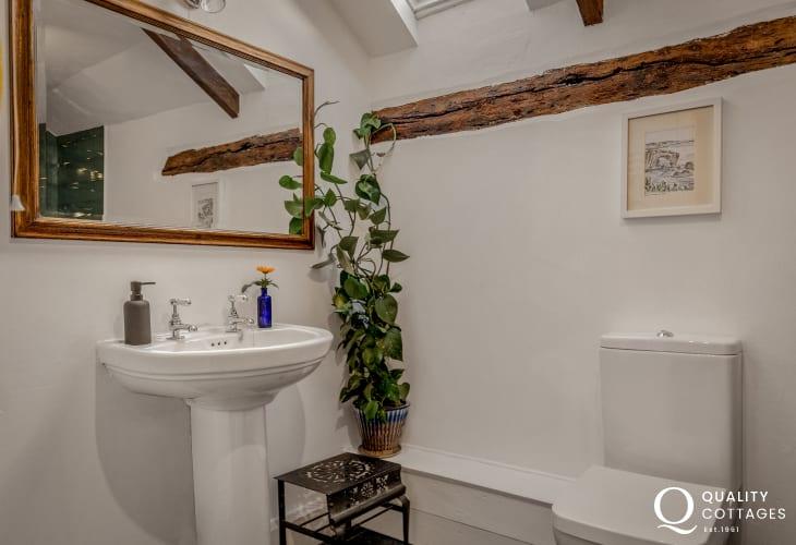 .Family bathroom bath, shower, WC, washbasin, heated towel rail and mirror in Bosherton, Pembrokeshire.