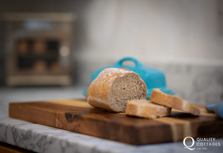 Bread and bread board in holiday cottage kitchen, by Bosherton Lily Ponds, Pembrokeshire.