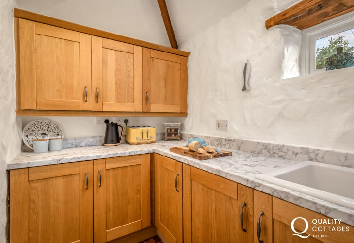 Well equipped shaker style kitchen in Boshterton holiday cottage in Pembrokeshire.