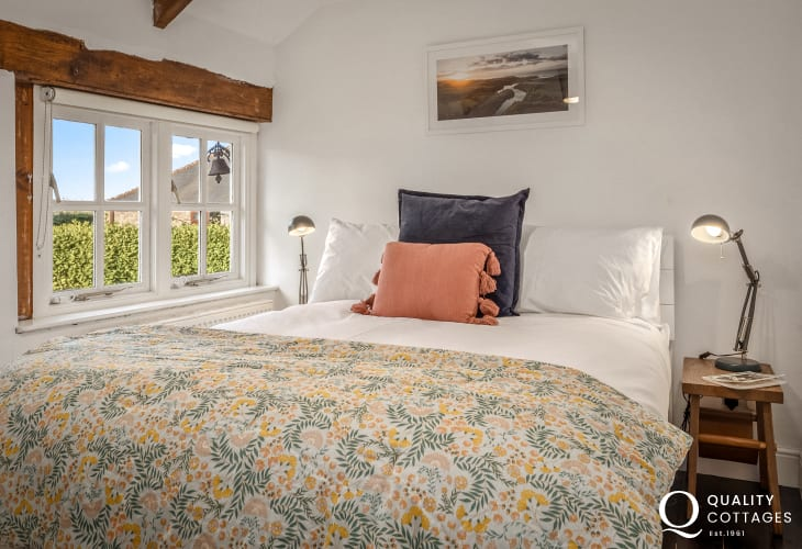 King-size bedroom with view out to Bosherton countryside, in Pembrokeshire.