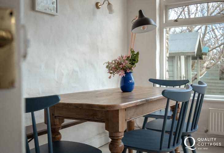 Dining table with seating for six in holiday cottage next to Bosherton Lily Ponds, Pembrokeshire.