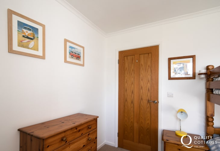 Twin bedroom with bunk bed, chest of drawers and bedside table - coastal holiday cottage on LLyn Peninsula, North Wales