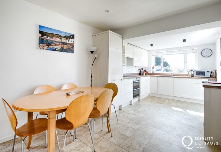 Kitchen / dining room with table seating eight inside dog friendly holiday cottage on the Llyn Peninsula, North Wales.