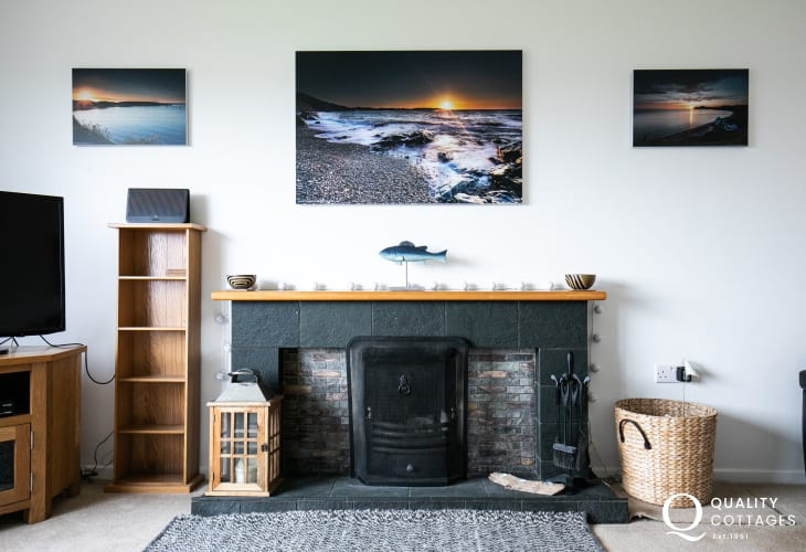 Holiday cottage lounge with open fire in Morfa Nefyn, on the Llyn Peninsula
