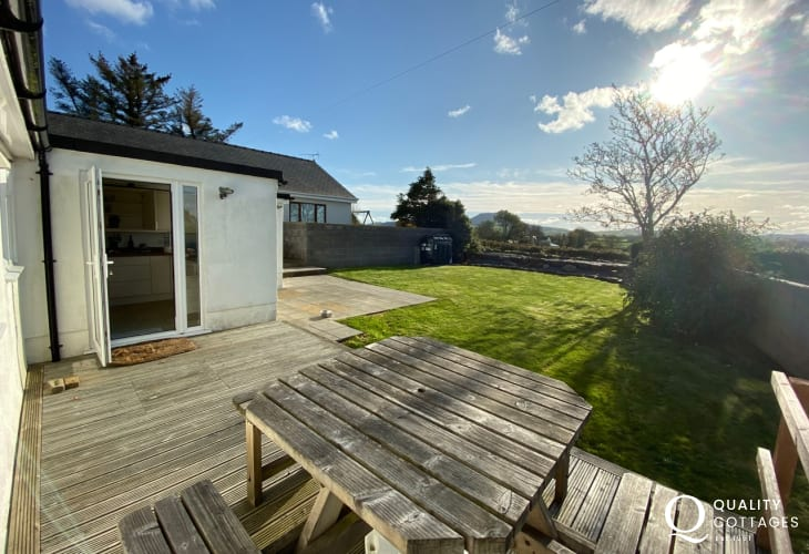 Pet friendly holiday cottage in Morfa Nefyn, Wales - enclosed large garden with lawn, decked seating area and scenic views