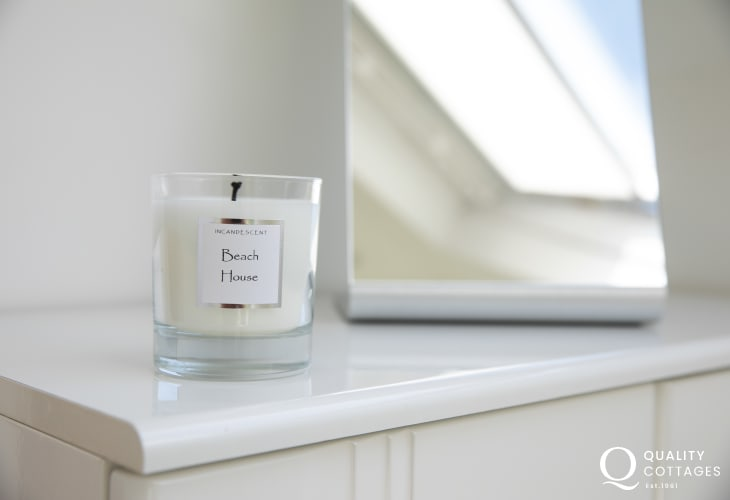 Scented candle in shower room of holiday cottage in Morfa Nefyn, North Wales