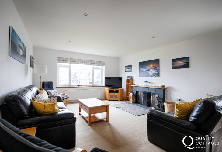 Holiday cottage in Llyn Peninsula, North Wales - Lounge with sofas, armchairs, TV and log fire.