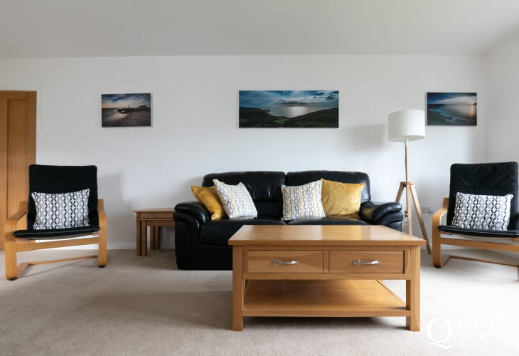 Coastal holiday cottage on Llyn Peninsula - lounge with sofa, chairs and coffee table.