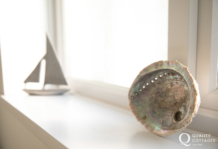 Seashell and boat ornament in family bathroom of holiday cottage in Morfa Nefyn, on The Llyn Peninsula, North Wales