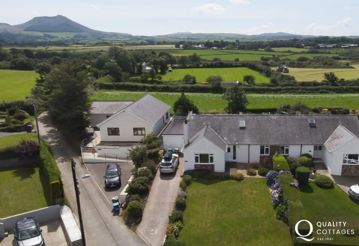 Aerial view of dog friendly holiday cottage with driveway in North Wales, in Morfa Nefyn, on The Llyn Peninsula. Sleeps 8.