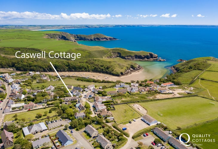Aerial photo of 'Caswell Cottage' with Solva Harbour and beach in the background - holiday cottage in Pembrokeshire.