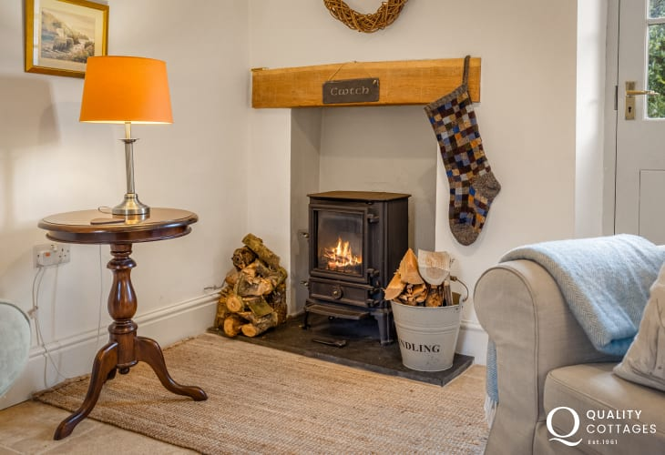 Log burning stove in dog friendly holiday cottage in Solva, Pembrokeshire. Sleeps five.