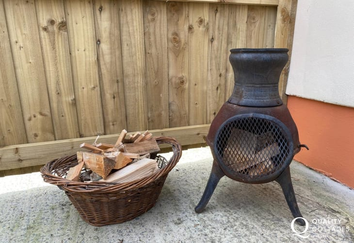 Enclosed patio garden with outdoor fire pit heater - holiday cottage near Amroth, Pembrokeshire.