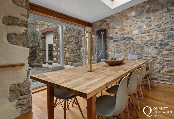 Large dining table in self catering holiday cottage in Newport, Pembrokeshire. Sleeps ten people.