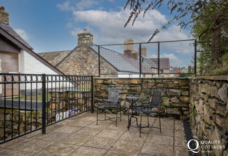 Enclosed garden with lawn on 3 tiers, ideal for children and pets with seating in holiday cottage in Newport, Pembrokeshire.