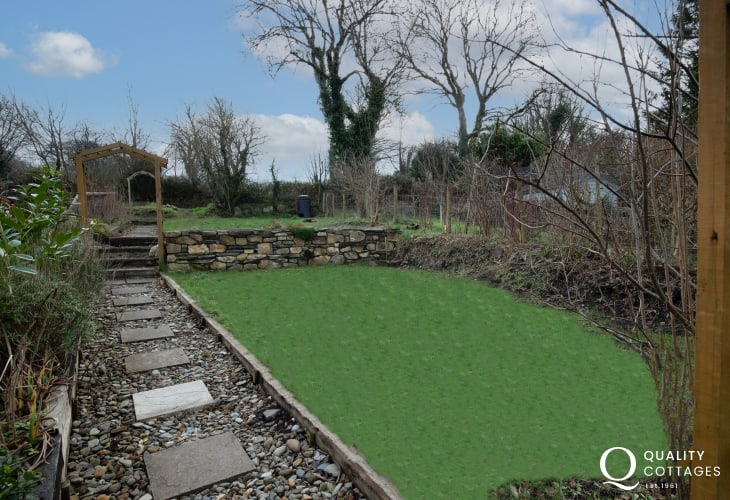 Enclosed garden with lawn area of dog friendly coastal holiday cottage in Newport, Pembrokeshire.