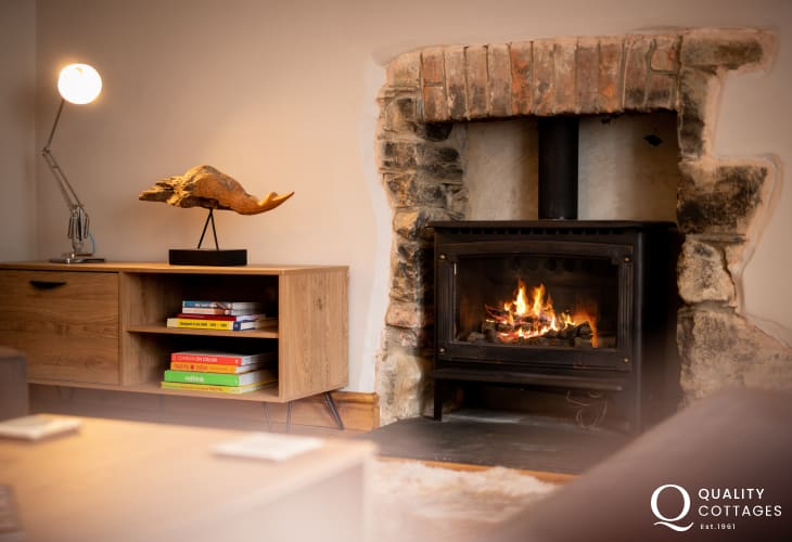 Log burner in characterful holiday cottage in Newport, Pembrokeshire. Sleeps ten people.