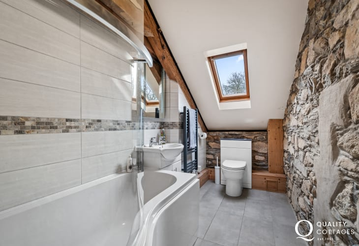 Holiday cottage in Newport, Pembrokeshire - ensuite bathroom on third floor with bath, shower, wash basin and Velux window.