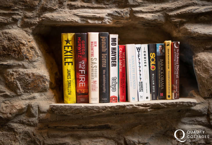 Reading shelf in snug room in holiday cottage in Newport, Pembrokeshire.