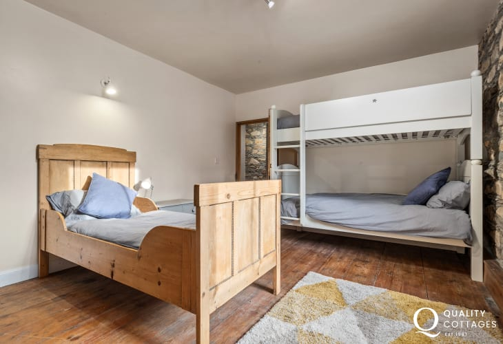 Children's bedroom with bunk bed and single sleigh bed in holiday cottage in Newport, Pembrokeshire.