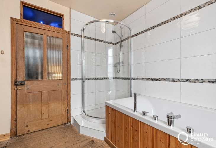 Family bathroom with WC, bath, separate shower and wash basin in holiday cottage in Newport, Pembrokeshire. Sleeps 10 people.