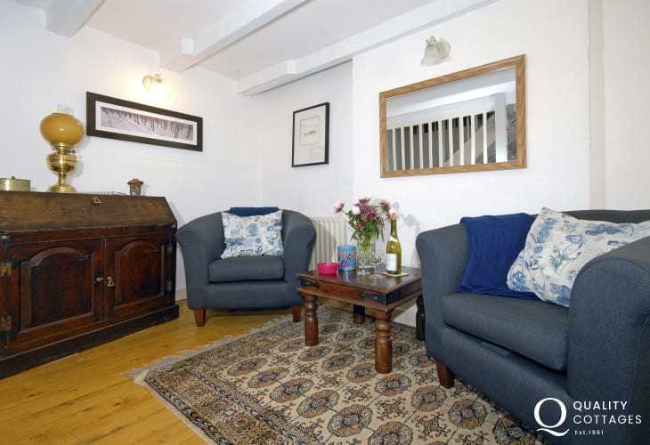 Holiday cottage on the Pembrokeshire coast - sitting room, wooden floors and beamed ceiling
