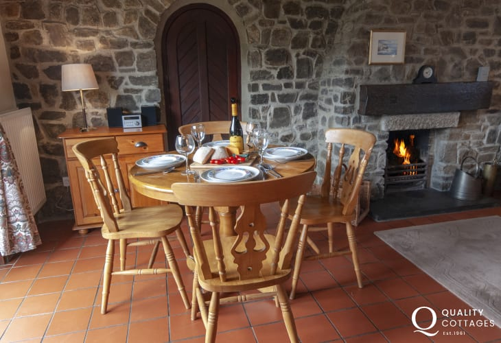 North Pembrokeshire holiday home - open plan dining area with open fire