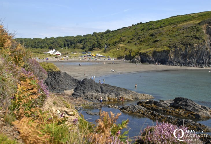 Pwllgwaelod Beach - horseshoe of silvery soft sand with lots of rock pools and over looked by the The Old Sailors Inn