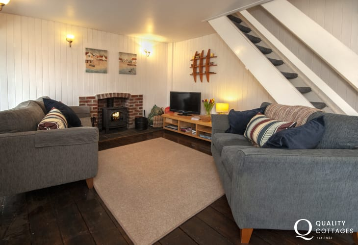Solva holiday cottage - lounge with WiFi and wood burner