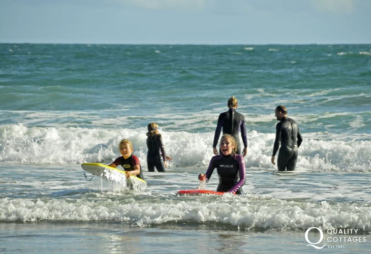 Enjoying the surf at Newgale - boards and wet suits can be hired from 'Newsurf' on the beach