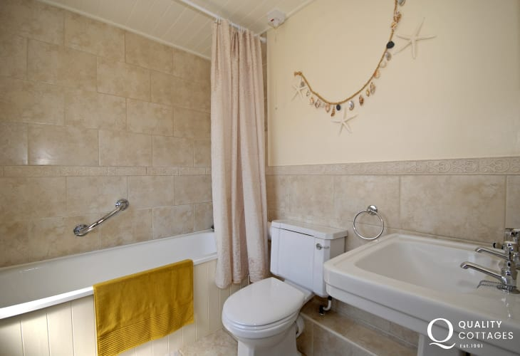 Solva holiday home - first floor family bathroom with shower over bath