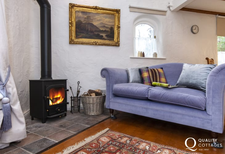 Living room with log burner in Wisteria Lodge