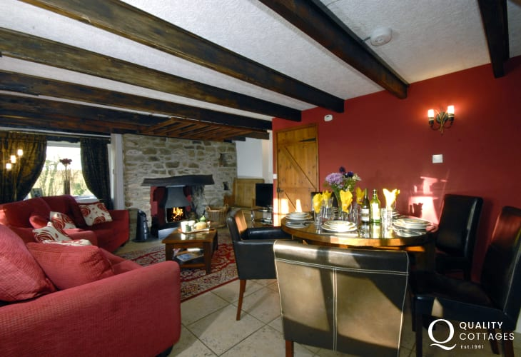 Solva holiday home - open plan dining/sitting room with open fire