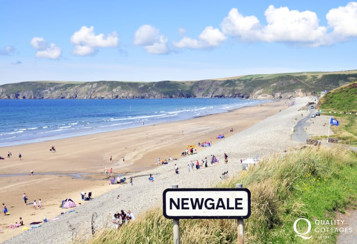 Newgale Beach (Blue Flag) is a magnificent two mile stretch of wide sand popular for surfing,  kite boarding