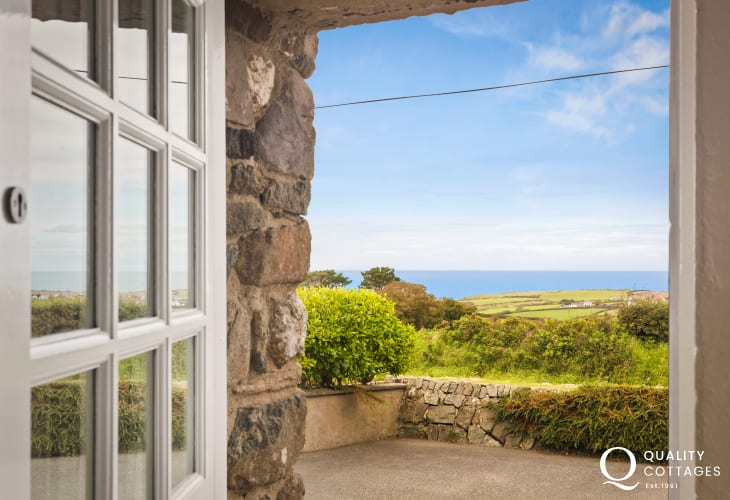 Ddoor opening onto sea views