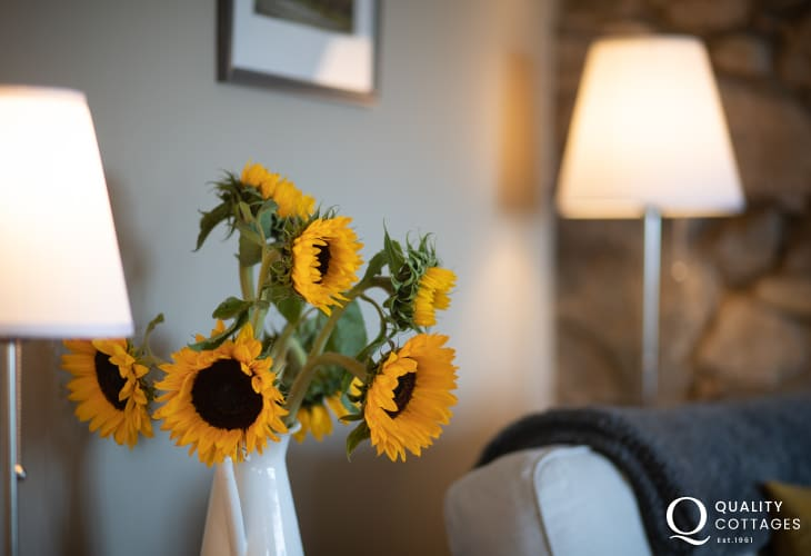 lamps and jug with sunflowers