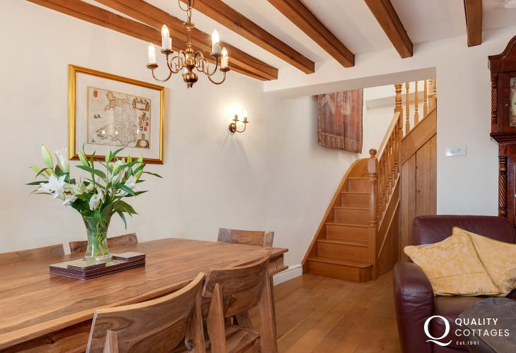 dining table and stairs leading to the upstairs of a holiday cottage in Pembrokeshire