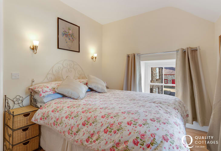 One of the double bedroonms of a historic cottage in Pembrokeshire