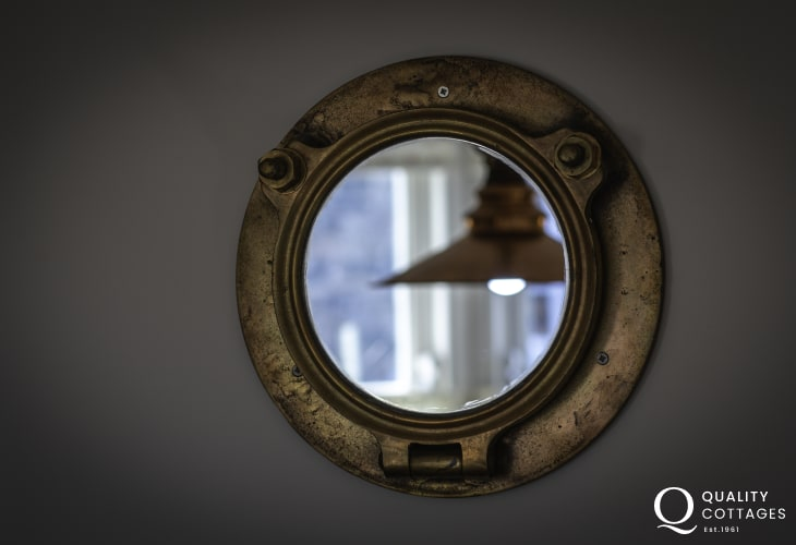 Port hole mirror in Newport holiday cottage