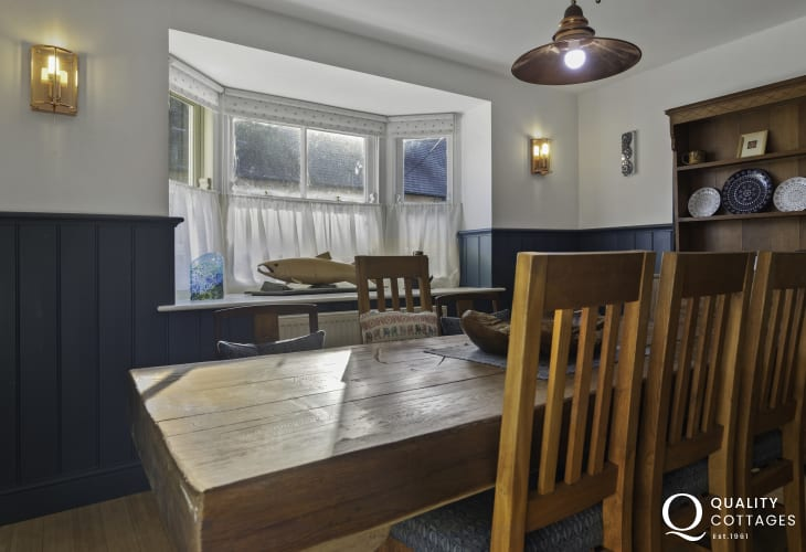 Panelled dining area with dining table, chairs and dresser