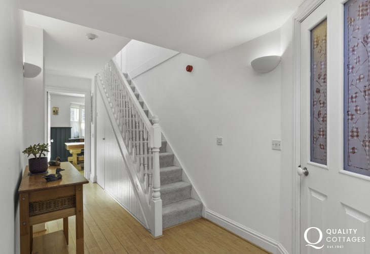 Entrance hallway with console table and stairs