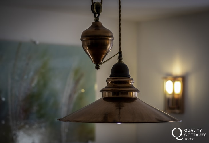 Feature lighting in dining room of Awen Ingli holiday cottage in Newport Pembrokeshire