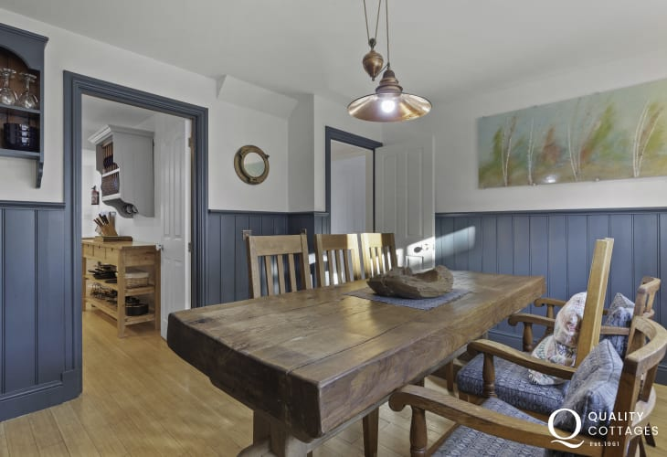 Panelled dining area leading to galley kitchen